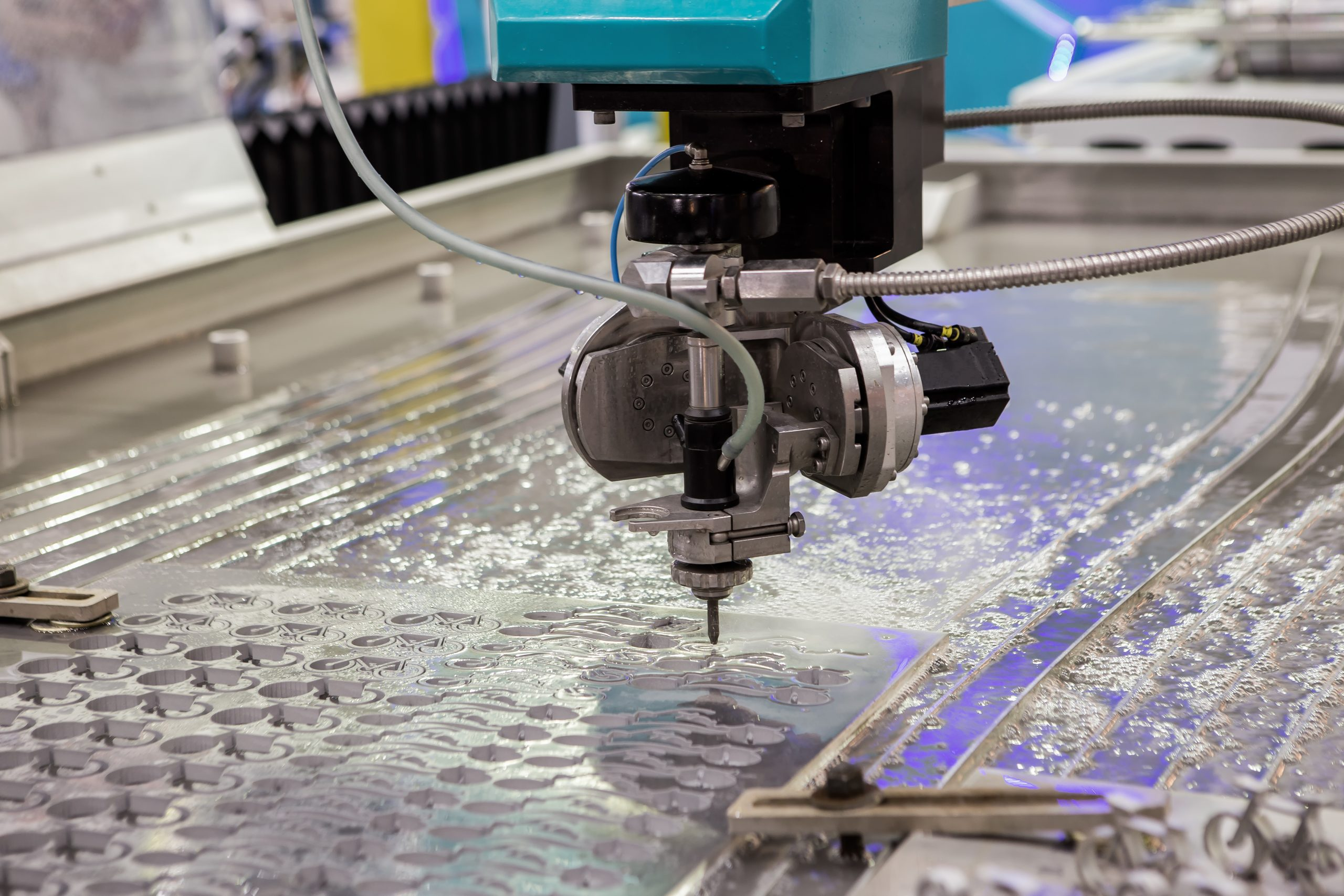 The water jet cutting CNC machine in working